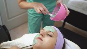 Woman relaxing in spa salon. Beautiful woman lying on the bed relaxing in spa salon with massage stock footage