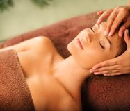 Woman relaxing in a spa salon Royalty Free Stock Images