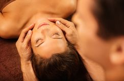 Woman relaxing in a spa salon Stock Photos