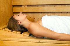 Woman relaxing in a spa Stock Photos