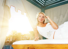 Woman relaxing in a spa tent Royalty Free Stock Image