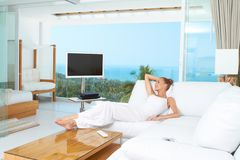 Woman relaxing in spacious bright living-room royalty free stock images