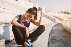 Woman relaxing after sports and drinking water Royalty Free Stock Image