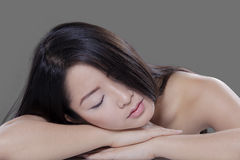 Woman relaxing in studio after skin treatment Royalty Free Stock Photography