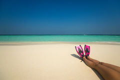 Woman relaxing on summer beach vacation holidays lying in sand. Stock Photos