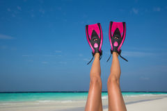 Woman relaxing on summer beach vacation holidays lying in sand. Stock Photography
