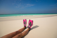Woman relaxing on summer beach vacation holidays lying in sand. Royalty Free Stock Photos