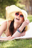 Woman Relaxing In Summer Garden Stock Images