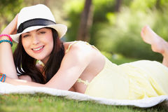 Woman Relaxing In Summer Garden Stock Photography