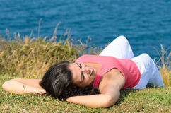 Woman relaxing in summer towards the sea Royalty Free Stock Photos