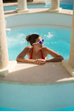 Woman relaxing on summer vacation at pool jacuzzi Stock Images