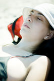Woman relaxing in the sun Royalty Free Stock Image