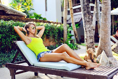 Woman relaxing on a sun lounger Royalty Free Stock Images