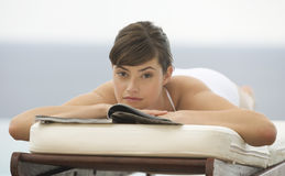 A woman relaxing on a sun lounger Royalty Free Stock Photo