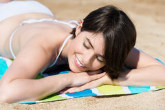 Woman relaxing sunbathing on the beach Royalty Free Stock Photos