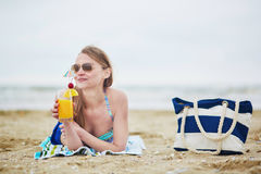 Woman relaxing and sunbathing on beach Stock Image