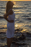 Woman relaxing at sunset sea Stock Photography