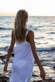 Woman relaxing at sunset sea Stock Image