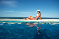 Woman relaxing in a swimming pool Stock Image