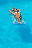 Woman relaxing at the swimming pool Royalty Free Stock Photos
