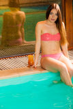 Woman relaxing at swimming pool edge. Leisure. Stock Photography