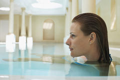 Woman Relaxing In Swimming Pool Stock Image