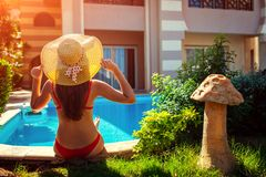 Woman relaxing by swimming pool. Summer vacation. All inclusive royalty free stock photo