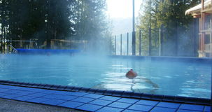 Woman relaxing in swimming pool. During wintertime stock video footage