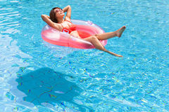 Woman relaxing in swimming pool Stock Photo