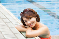 Woman relaxing in   swimming pool Royalty Free Stock Photo