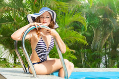 Woman relaxing in swimming pool Stock Photos