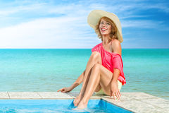 Woman relaxing in swimming pool Royalty Free Stock Images