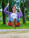 Woman relaxing swing playground Royalty Free Stock Photos