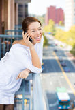 Woman relaxing talking on cell phone Stock Image