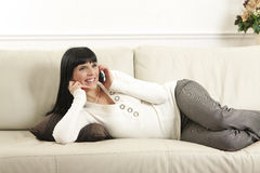 Woman relaxing  and talking on the telephone Royalty Free Stock Image