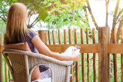 Woman relaxing on terrace Stock Photos