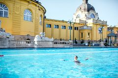 Woman relaxing at the thermal bathes in Budapest. Woman relaxing at the famous Szechenyi thermal bathes in Budapest, Hungary Royalty Free Stock Photos