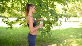 Woman Relaxing After Training In The Park stock video footage