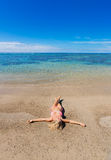 Woman relaxing on tropical beach Royalty Free Stock Photos