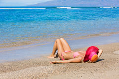 Woman relaxing on tropical beach Royalty Free Stock Images