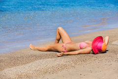 Woman relaxing on tropical beach Royalty Free Stock Image