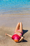 Woman relaxing on tropical beach Stock Photo