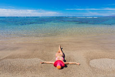 Woman relaxing on tropical beach Stock Image