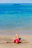 Woman relaxing on tropical beach Royalty Free Stock Photo