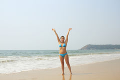 Woman relaxing on the tropical beach Stock Photography