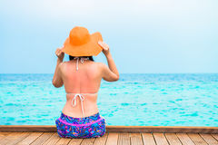 Woman is relaxing on the tropical beach Stock Photo