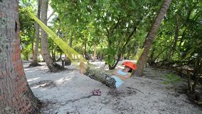 Woman is relaxing on the tropical beach stock video footage