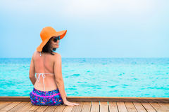 Woman is relaxing on the tropical beach Royalty Free Stock Photo