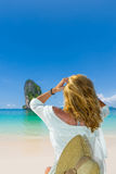 Woman relaxing on a tropical beach Royalty Free Stock Images