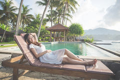 woman relaxing on tropical beach Stock Images